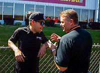 May 6, 2018; Commerce, GA, USA; NHRA president Glenn Cromwell (right) talks with funny car driver Jonnie Lindberg during the Southern Nationals at Atlanta Dragway. Mandatory Credit: Mark J. Rebilas-USA TODAY Sports