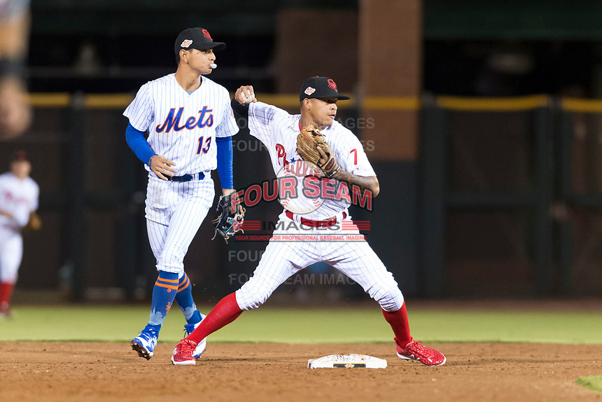 Scottsdale Scorpions shortstop Arquimedes Gamboa (7), of the Philadelphia Phillies organization, throws to first base in front of second baseman Andres Gimenez (13) during an Arizona Fall League game against the Surprise Saguaros at Scottsdale Stadium on October 15, 2018 in Scottsdale, Arizona. Surprise defeated Scottsdale 2-0. (Zachary Lucy/Four Seam Images)
