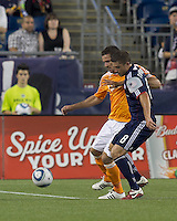 Houston Dynamo defender Hunter Freeman (21) and New England Revolution midfielder Chris Tierney (8) battle for the ball. In a Major League Soccer (MLS) match, the New England Revolution tied Houston Dynamo, 1-1, at Gillette Stadium on August 17, 2011.