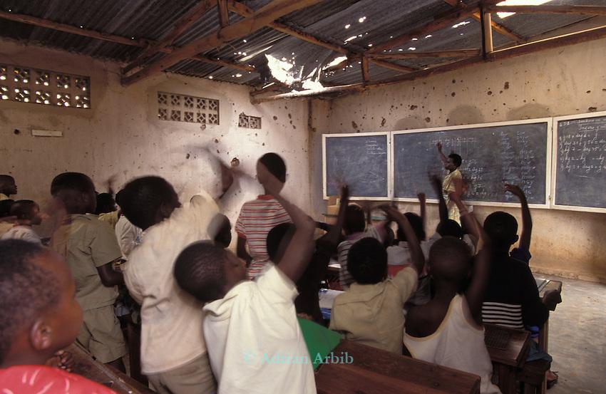 Children in  a war damaged  school in Kigali, Rwanda .