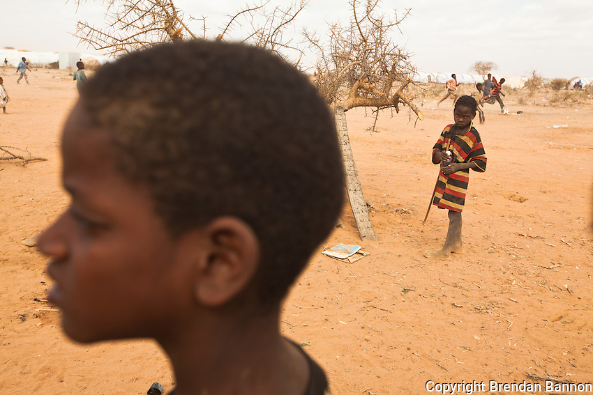 Somali children play in a field next to an open-air madrasa in Ifo extention, aprt of  a complex of three camps surrounding Dadaab, Kenya