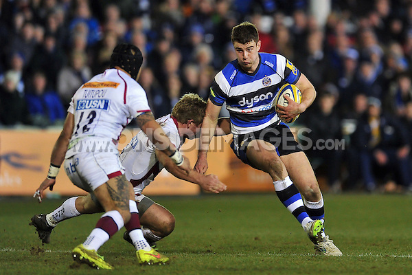 Ollie Devoto of Bath Rugby takes on the Sale Sharks defence. Aviva Premiership match, between Bath Rugby and Sale Sharks on March 6, 2015 at the Recreation Ground in Bath, England. Photo by: Patrick Khachfe / Onside Images