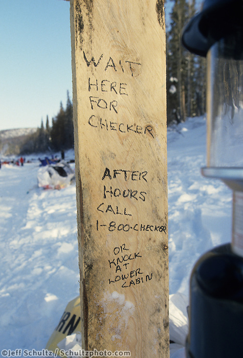 Humorous check-in sign at Eagle Island Checkpoint during the 93 Iditarod 1993