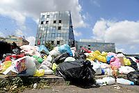 Roma, 1 Agosto 2016<br /> Rifiuti a Roma, cassonetti pieni e rifiuti in strada a Tor Sapienza e Tor Tre Teste.<br /> Waste Emergency in Rome, bins for garbage filled and waste in the street.