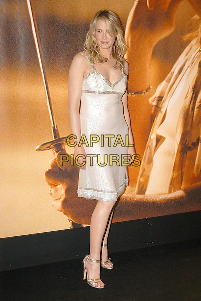 DARYL HANNAH .Kill Bill Vol. 2 photocall.April 23rd, 2004.full length, full-length, white, silver dress, silver sandals.www.capitalpictures.com.sales@capitalpictures.com.© Capital Pictures.