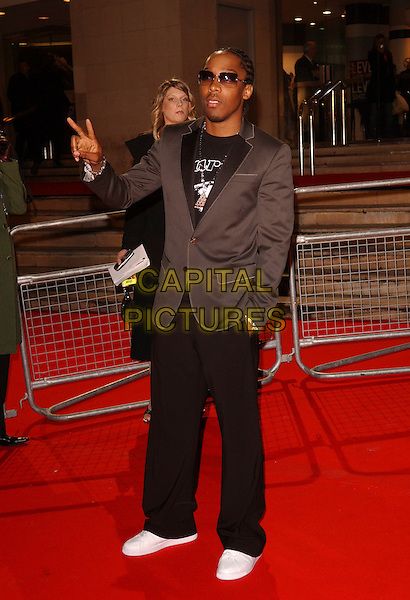 SIMON WEBBE.The Brit Awards 2006.Earls Court, London England.15 February 2006.Ref: FIN.earl's pop music Brits full length black grey gray jacket trousers .www.capitalpictures.com.sales@capitalpictures.com.© Capital Pictures.