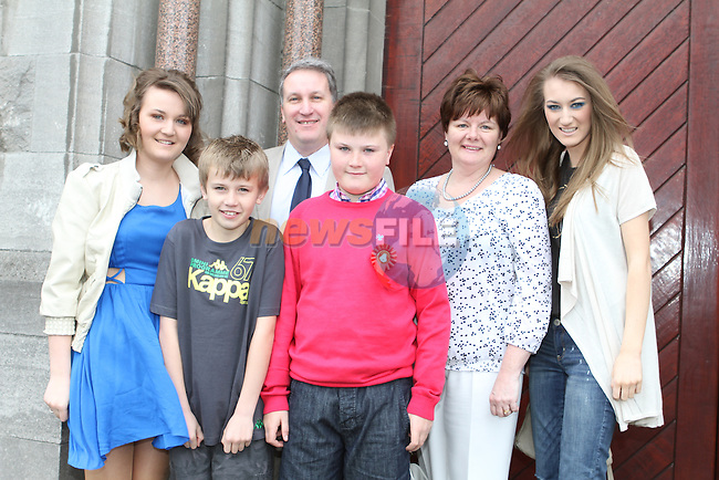 Ross Kinch with his family at Le Cheile Confirmation in St.Mary's Church...(Photo Jenny Matthews/www.newsfile.ie)