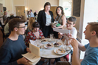 "Associate Professor and Chair of the Music Department David Kasunic and the students of his Music 268 ""Vienna 1890-1914"" class recreate a turn-of-the-century Viennese coffee house on Wednesday, April 27, 2016 in Erdman Hall common room. A third of the class will be waiters serving Viennese coffee called Einspänner and pastries called Sachertorte, Linzer Torte, and Apfelstrudel and the rest of the class will be in character as people from turn-of-the-century Vienna who are related to their research, from Sigmund Freud to Carl Menger. Live background music provided by Oxy guitar instructor Ron Berman.<br /> (Photo by Marc Campos, Occidental College Photographer)"
