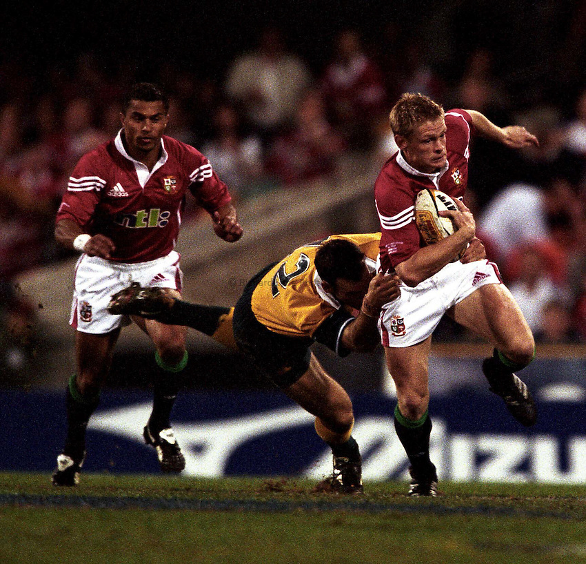 Photo. Richard Lane. .Lions Tour 2001. First Test, Australia v The Lions at the Gabba, Brisbane, Australia. 30/6/2001.Iain Balshaw here going round Nathan Grey, was back to his usual ways after coming on at fullback from half time.