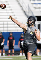 NWA Democrat-Gazette/JASON IVESTER --07/10/2015--<br /> Bentonville senior Kasey Ford attempts a pass against Westmoore during the Southwest Elite 7-on-7 Tournament on Friday, July 10, 2015, at Rogers High School.