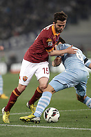 Calcio, Serie A: Roma vs Lazio. Roma, Stadio Olimpico, 8 aprile 2013..AS Roma midfielder Miralem Pjanic, of Bosnia, is fouled by Lazio midfielder Hernanes, of Brazil, right, during the Italian serie A football match between A.S. Roma  and Lazio at Rome's Olympic stadium, 8 april 2013..UPDATE IMAGES PRESS/Isabella Bonotto