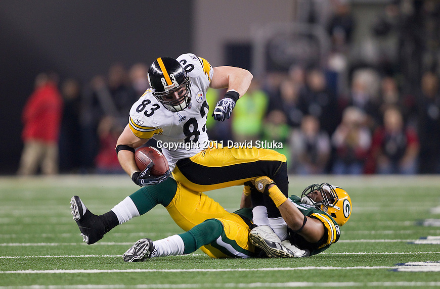Green Bay Packers linebacker Desmond Bishop (55) tackles Pittsburgh Steelers tight end Heath Miller (83) during Super Bowl XLV on Sunday, February 6, 2011, in Arlingto, Texaas. The Packers won 31-25. (AP Photo/David Stluka)
