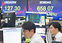Economy, Oct 16, 2017 : Currency traders work as screens show exchange rate (top L) and KOSDAQ (Korea Securities Dealer Automated Quotation) at a dealing room of KEB Hana Bank in Seoul, South Korea. (Photo by Lee Jae-Won/AFLO) (SOUTH KOREA)