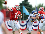 SIOUX FALLS, SD - SEPTEMBER 7:  Connor Burchill #14 from Lincoln passes to a receiver against O'Gorman in the first quarter of their game at the 2013 Presidents Bowl at Howard Wood Field. (Photo by Dave Eggen/Inertia)