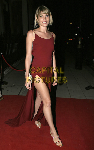 MEREDITH OSTROM.Dom Perignon VIP Party, 13 Grosvenor Crescent, London, 8th September 2004..full length red dress side split leg gold shoes .Ref: AH.www.capitalpictures.com.sales@capitalpictures.com.©Capital Pictures.