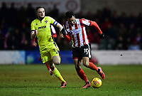 Lincoln City's Matt Green vies for possession with Cheltenham Town's Carl Winchester<br /> <br /> Photographer Chris Vaughan/CameraSport<br /> <br /> The EFL Sky Bet League Two - Lincoln City v Cheltenham Town - Tuesday 13th February 2018 - Sincil Bank - Lincoln<br /> <br /> World Copyright &copy; 2018 CameraSport. All rights reserved. 43 Linden Ave. Countesthorpe. Leicester. England. LE8 5PG - Tel: +44 (0) 116 277 4147 - admin@camerasport.com - www.camerasport.com