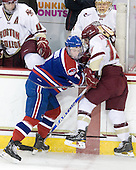 Tommy Cross (BC - 4), Maury Edwards (Lowell - 7), Cam Atkinson (BC - 13), John Muse (BC - 1) - The Boston College Eagles defeated the visiting University of Massachusetts-Lowell River Hawks 5-3 (EN) on Saturday, January 22, 2011, at Conte Forum in Chestnut Hill, Massachusetts.