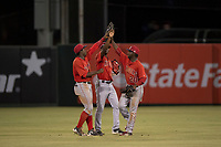 AZL Angels outfielders Johan Sala (5), Trent Deveaux (17), and D'Shawn Knowles (20) celebrate a victory after an Arizona League game against the AZL Diamondbacks at Tempe Diablo Stadium on June 27, 2018 in Tempe, Arizona. AZL Angels defeated the AZL Diamondbacks 5-3. (Zachary Lucy/Four Seam Images)