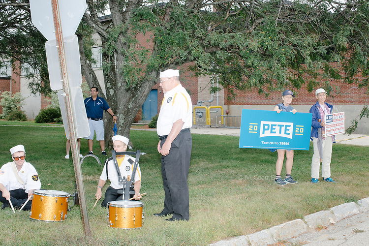 Supporters of Democratic presidential candidate and South Bend, Ind., mayor Pete Buttigieg hold signs at the beginning of the Labor Day Parade in Milford, New Hampshire, on Mon., September 2, 2019. Candidates Bernie Sanders and Vermin Supreme were the only candidates who marched in the parade this year.