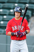 Catcher Carlos Coste (7) of the Greenville Drive waits his turn for batting practice on the team's Media Day first workout on Tuesday, April 1, 2014, at Fluor Field at the West End in Greenville, South Carolina. (Tom Priddy/Four Seam Images)