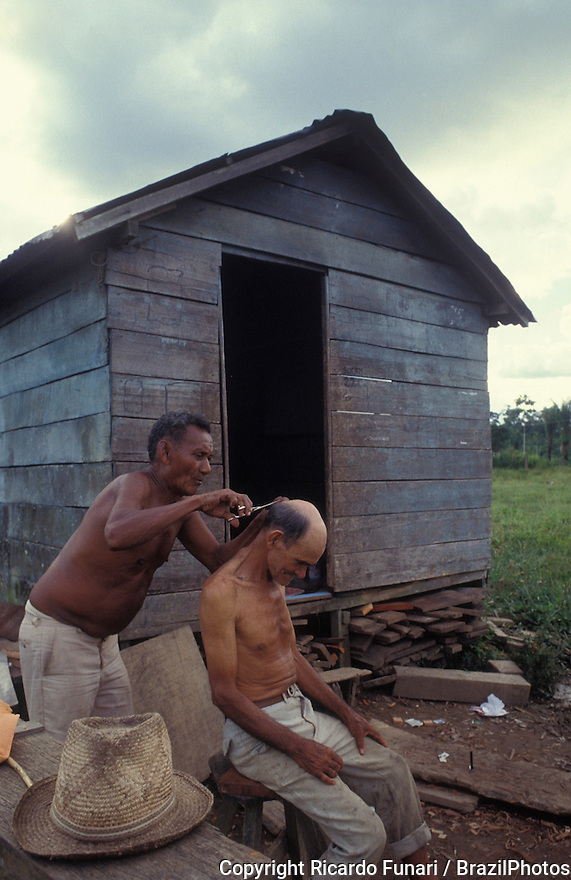 Multi-ethnicity, multiracial community, Friendship between neighbors, black man cuts the hair of a caucasian man. Outskirts of Rio Branco city, capital of Acre State, Amazon region, north Brazil.