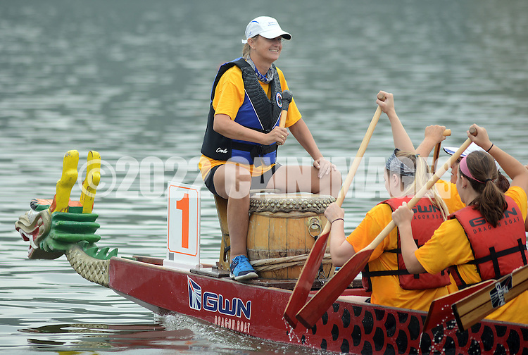 PDRAGON20P<br /> Laurie McHugh bangs a drum as she commands her team during the first annual Bucks County Dragon Boat Festival on Lake Luxembourg at Core Creek Park Saturday September 19, 2015 in Langhorne, Pennsylvania.  The purpose of the event is to Paddle Out Hunger with proceeds benefitting Bucks County Housing Group. (William Thomas Cain/For The Inquirer)