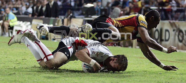 PICTURE BY VAUGHN RIDLEY/SWPIX.COM - Rugby League - Rugby League World Cup 2008 - England v Papua New Guinea - Dairy Farmers Stadium, Townsville, Australia - 25/10/08...Copyright - Simon Wilkinson - 07811267706...England's Lee Smith scores his first try as PNG's John Wilshere fails to stop him.