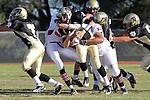 Palos Verdes, CA 11/12/10 - Andrew Bucklin (Palos Verdes #72) and Brock Dale (Peninsula #7) in action during the Palos Verdes - Peninsula varsity football game at Peninsula High School.
