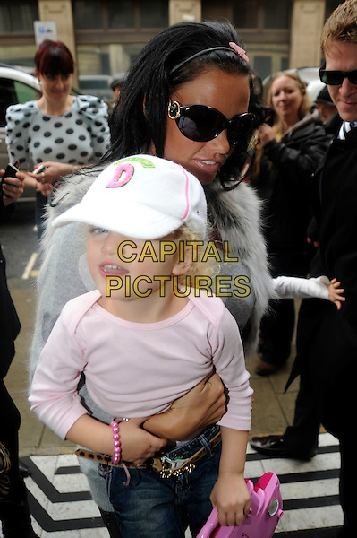 KATIE PRICE (JORDAN), PRINCESS TIAAMII ANDRE.Arriving at BBC Radio 2, London, England..October 27th, 2010.kid child family mother mom mum daughter grey gray white pink heart print jumper sweater hat half length fur gilet toy carrying lifting sunglasses shades .CAP/IA.©Ian Allis/Capital Pictures.