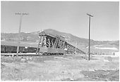 D&amp;RGW Sargent coaling trestle with a couple of gondolas and a string of stock cars.  The stock pens are at right.<br /> D&amp;RGW  Sargent, CO  Taken by Richardson, Robert W. - 3/31/1955