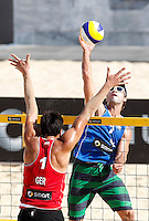 Brazil's Bruno Schmidt, right, in action against  Germany's Jonathan Erdmann at the Beach Volleyball World Tour Grand Slam, Foro Italico, Rome, 22 June 2013. Brazil defeated Germany 2-0.<br /> UPDATE IMAGES PRESS/Isabella Bonotto