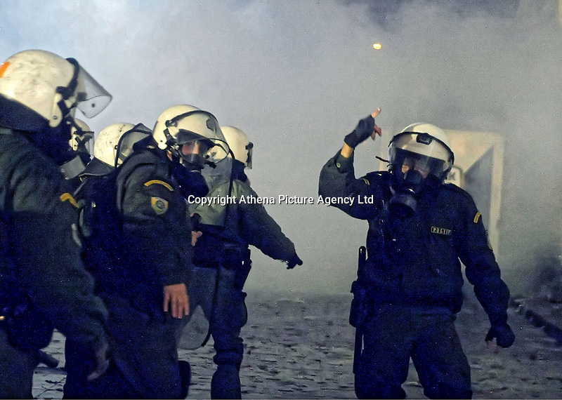 Pictured: Riot police outside Toumba Stadium in Thessaloniki, Greece. Sunday 25 February 2018<br /> Re: Sunday's Greek Super League derby between PAOK Thessaloniki and Olympiakos was called off after Olympiakos' manager Oscar Garcia was struck in the face by an object believed to be a till machine paper roll, thrown by a spectator minutes before kick-off.<br /> Garcia left Toumba Stadium for a local hospital to seek treatment for a bloodied lip.<br /> The incident prompted the Olympiakos team to leave the pitch in protest before riots erupted outside the ground.<br /> Angry PAOK fans leaving the stadium then clashed with police who used tear gas to quell the violence.