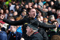 A Swansea fan celebrates during the Barclays Premier League match between Stoke City and Swansea City played at Britannia Stadium, Stoke on April 2nd 2016