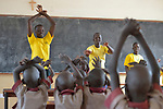 A class in the Loreto Primary School in Rumbek, South Sudan. The Loreto Sisters began a secondary school for girls in 2008, with students from throughout the country, but soon after added a primary in response to local community demands.<br /> <br /> The older girls leading the class are students of the Loreto Girls Secondary School. They took charge of the primary class so the regular teacher could attend a staff meeting.