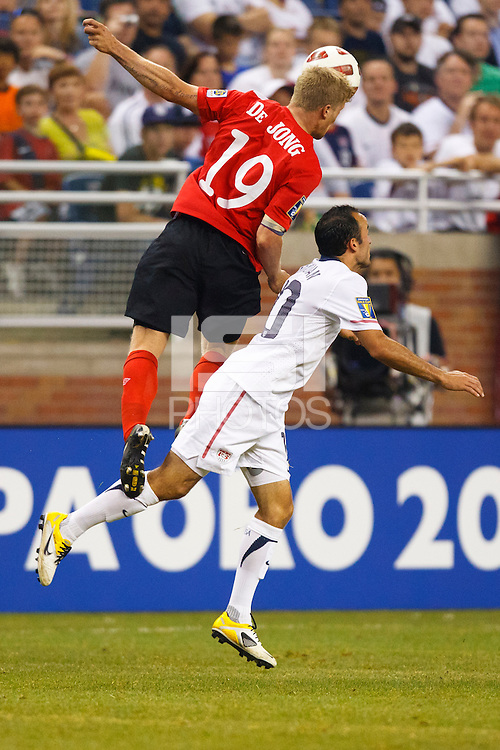 7 June 2011: Canada defender Marcal De Jong (19) heads the ball over USA Men's National Team midfielder Landon Donovan (10) during the CONCACAF soccer match between USA MNT and Canada MNT at Ford Field Detroit, Michigan. USA won 2-0.
