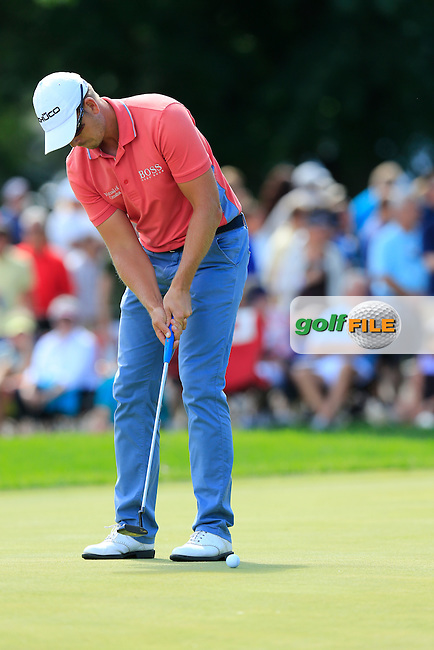 Henrik Stenson (SWE) putts on the 9th green during Sunday's Final Round of the 2013 Bridgestone Invitational WGC tournament held at the Firestone Country Club, Akron, Ohio. 4th August 2013.<br /> Picture: Eoin Clarke www.golffile.ie