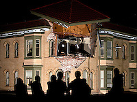 Spectators stand atop a parking garage for a better view of a damaged building after a 6.1 magnitude earthquake hit the San Francisco Bay Area at 3:20 am, in Napa, California, USA, 24 August 2014. More than 70 people were sent to hospital with injuries and power outages darkened multiple cities in northern California after a 6.1-magnitude earthquake struck early on 24 August. The United States Geological Survey (USGS) said the earthquake struck at 3:20 am (1020 GMT) at a depth of 10.8 kilometres. It was located nine kilometres south-west of the Napa wine region, and 81 kilometres north of San Francisco.