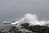 Waves crashing over jetty