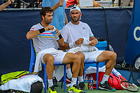 Washington, DC - August 3, 2019:  Jean-Julien Rojer (NED)on the left and Horia Tecau (ROU) on the right take a break between sets during the  Men Doubles semi finals at William H.G. FitzGerald Tennis Center in Washington, DC  August 3, 2019.  (Photo by Elliott Brown/Media Images International)