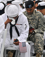 100702-N-7981E-120 .SAN DIEGO (July 2, 2010) Personnel Specialist Seaman Apprentice Ronald Skilang, from the Republic of Palau, assigned to Personnel Support Detachment Afloat West, wipes away tears as he prepares to take the oath of citizenship during a naturalization ceremony on the flight deck of the USS Midway Museum. Three hundred service members from 51 countries became U.S. citizens during the ceremony sponsored by U.S. Citizenship and Immigration Services. (U.S. Navy photo by Mass Communication Specialist 2nd Class James R. Evans/Released).
