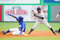 Jerrell Allen (9) of the Burlington Royals slides into second base as Princeton Rays shortstop Adderly Rosa (4) throws to first base to complete a double play at Burlington Athletic Park on July 5, 2013 in Burlington, North Carolina.  The Royals defeated the Rays 5-4 in game two of a doubleheader.  (Brian Westerholt/Four Seam Images)
