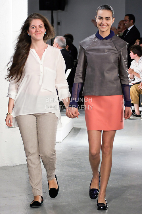 Graduting student designer Huner Aldermir, walks runway with model at the close of the 2012 Pratt Institute fashion show, at Center548 NYC, on April 26, 2012.