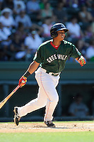 Third baseman Rafael Devers (13) of the Greenville Drive bats in a game against the Charleston RiverDogs on Sunday, June 28, 2015, at Fluor Field at the West End in Greenville, South Carolina. Devers is the No. 6 prospect of the Boston Red Sox, according to Baseball America. Charleston won, 12-9. (Tom Priddy/Four Seam Images)