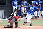 Western Nevada's Connor Klein beats the throw to the plate against Colorado Northwestern's Jeremy Lewallen in a college baseball game at John L. Harvey Field in Carson City, Nev., on Friday, April 11, 2014. <br /> Photo by Cathleen Allison/Nevada Photo Source
