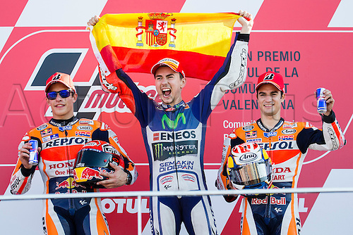 08.11.2015 Cheste, Valencia, Spain, Grand Prix Motul of Comunitat Valenciana. Marc Marquez (ESP), Repsol Honda Team rider, The World Champion 2015 Jorge Lorenzo (ESP), Movistar Yamaha MotoGP rider  and Dani Pedrosa (ESP), Repsol Honda Team rider, celebrate on the podium after the MotoGP in the Grand Prix Motul of Comunitat Valenciana  from the Circuito de Cheste.