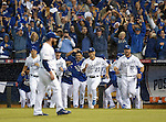Royals team group,<br /> OCTOBER 5, 2014 - MLB :<br /> Jeremy Guthrie, Johnny Giavotella, Norichika Aoki and Erik Kratz of the Kansas City Royals celebrate as they run towards their teammate Greg Holland (front) after winning the American League Division Series (ALDS) Game 3 against the Los Angeles Angels at Kauffman Stadium in Kansas City, Missouri, United States. (Photo by AFLO)