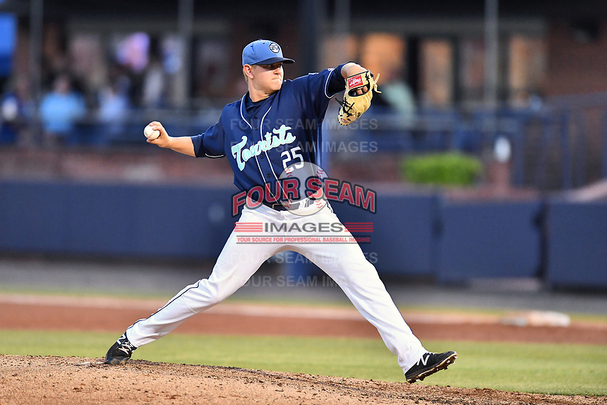 Asheville Tourists starting pitcher Will Gaddis (25) delivers a pitch during a game against the Greensboro Grasshoppers  at McCormick Field on May 10, 2018 in Asheville, North Carolina. The Tourists defeated the Grasshoppers 9-3. (Tony Farlow/Four Seam Images)