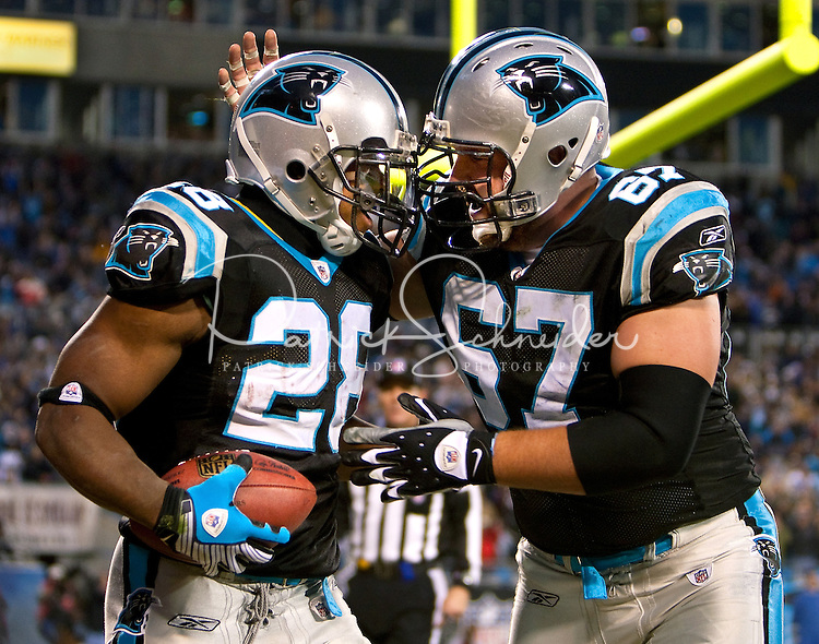 Carolina Panthers running back Jonathan Stewart (28) celebrates a touchdown against Ryan Kalil (67) during an NFL football game at Bank of America Stadium in Charlotte, NC.