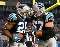 Carolina Panthers running back Jonathan Stewart (28) celebrates a touchdown against Ryan Kalil (67) during an NFL football game at Bank of America Stadium in Charlotte, NC.