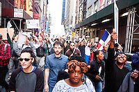 "Finally breaking free of the police's orders to stay on the sidewalks, protesters rush up 46th Street to Times Square on October 15, 2011 in New York City in support of the ""Occupy Wall Street"" movement."